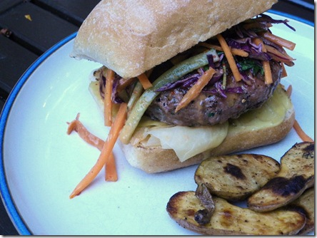 blue valley pork burger with slaw and potatoes